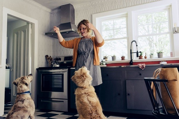 woman playing with her dogs