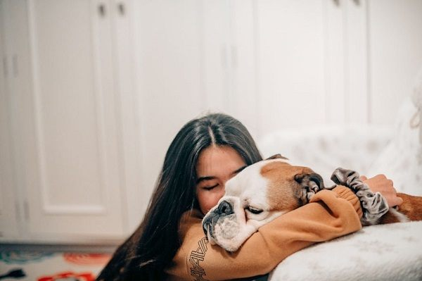 woman hugging her pet dog